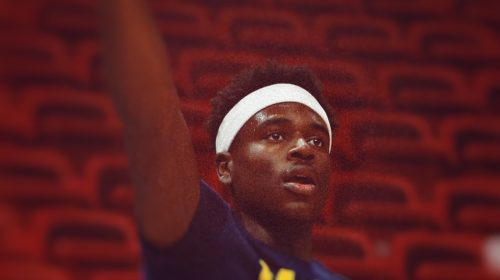 Edited photo of Aaron Holiday, original photo by Michael Reaves/Getty Images