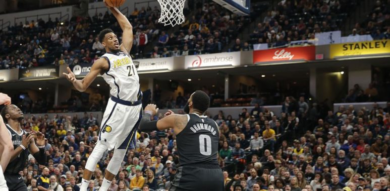 Indiana Pacers forward Thaddeus Young (21) dunks against Detroit Pistons center Andre Drummond (0) during the 4th quarter of their match at Bankers Life Fieldhouse. Photo via Brian Spurlock, USA TODAY Sports